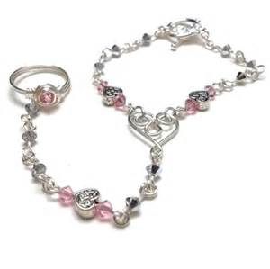 Celtic heart slave bracelet ring with pink and silver crystals