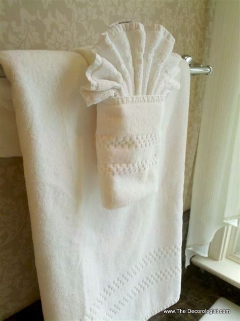 how to fold bathroom towels decoratively the art of towel folding and the karate chopped pillow