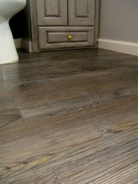 Redoing our flooring with peel & stick tile that looks