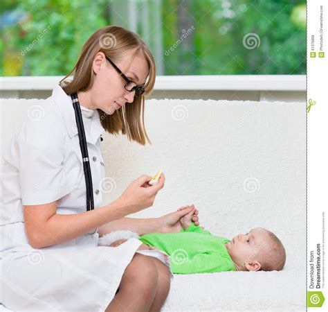 Physician Background Check Doctor Checks The Temperature Of Baby Stock Photo Image 61376868