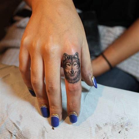 finger tattoo nyc a micro wolf tattoo by liz markov at bang bang nyc dream