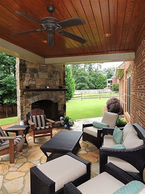 cozy covered patio with outdoor fireplace outdoorspaces