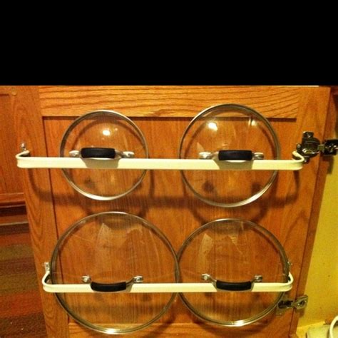 rack for pot lids made by installing cheap curtain rods to