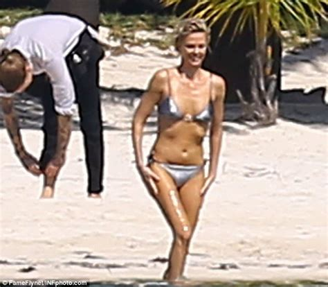 Charlize Theron Got Rid Of The Black Do by Charlize Theron Shows Toned Physique As She Rides