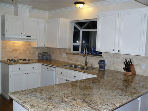 backsplash  black granite countertops beige mexican