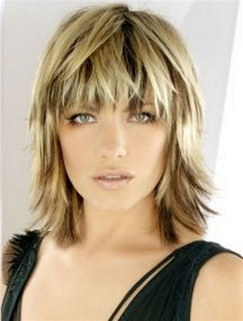 hairstyle with a few bangs blonde medium length choppy shag haircut with wispy bangs
