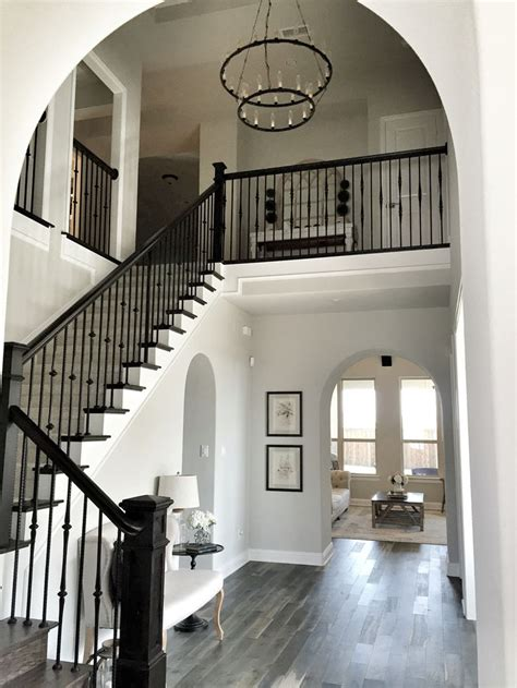 gray and white l shade wall paint color throughout the house repose gray by