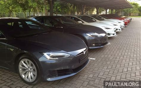 tesla model  greentech malaysia begins  deliveries