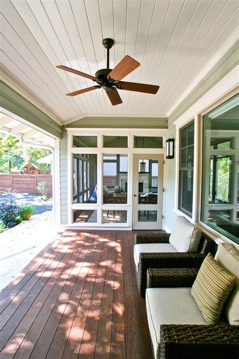 covered porch features wicker armchairs dark wood
