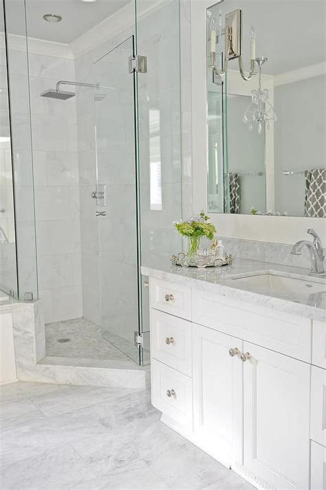 white marble tiles bathroom corner shower with mosaic marble floor transitional