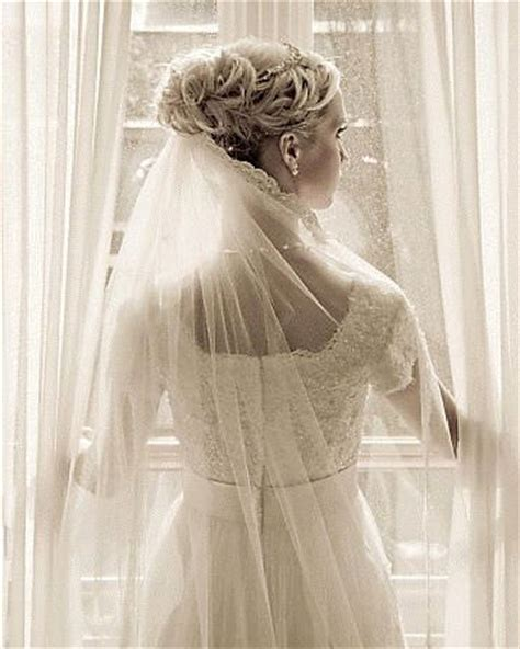 Wedding Updo With Veil Above by 10 Beautiful Bridal Hair Accessory Ideas