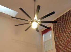 an electrician install ceiling fans and heavy light