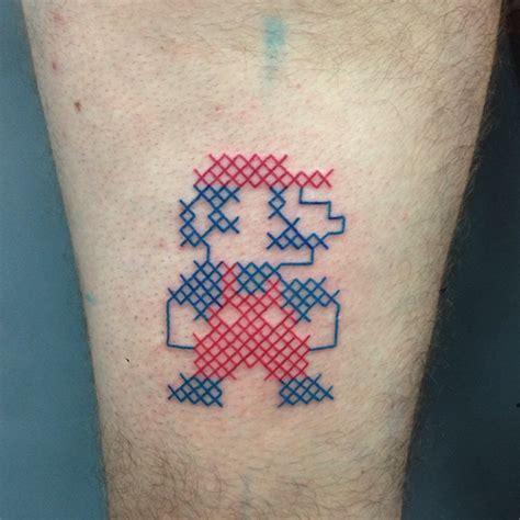 conhe 231 a mariette e suas delicadas tatuagens em ponto cruz