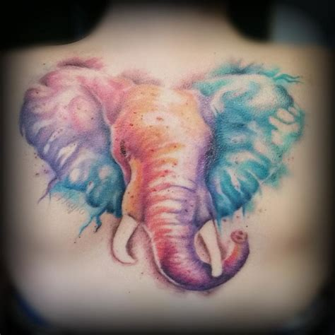 watercolor style elephant back piece by haylo tattoos