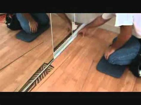 How to finish off a laminate planking floor edge: next to
