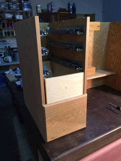 installing drawer fronts and finish sanding the sewing cabinet