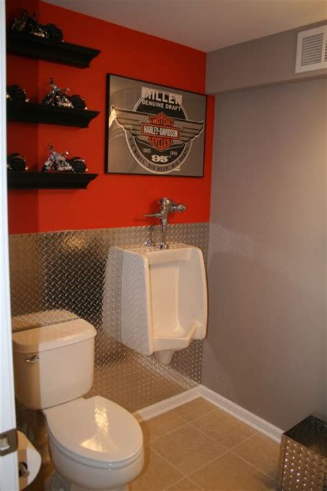 bathroom in garage cave bathroom the ideal bathroom for the and harley lover just a splash of orange and