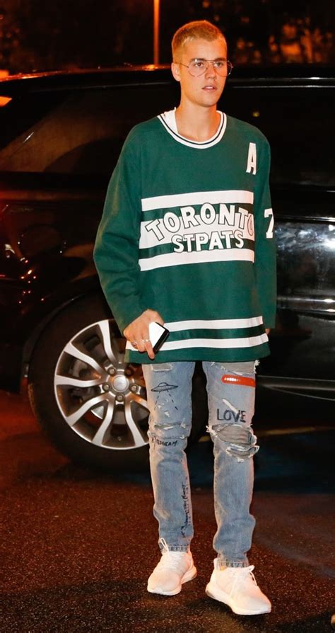 justin bieber wears toronto maple leafs st pats jersey visitor on earth and adidas