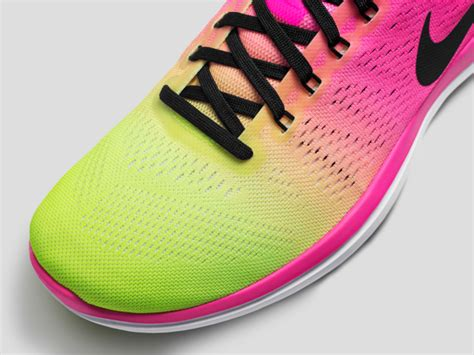 pink and lime green running shoes navis