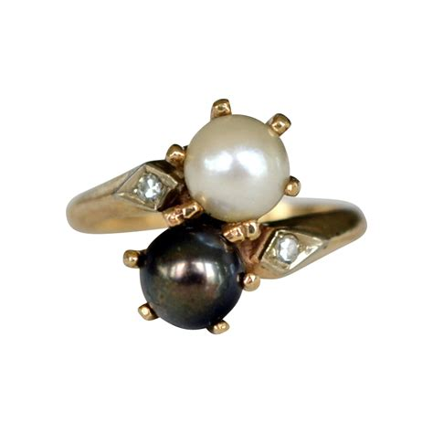 black and white cultured pearl 14k bypass ring with