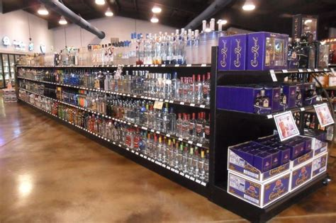 Liquor Store Shelf by Black Gondola Shelving With End Caps And Black Solid Board