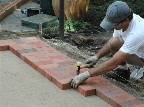laying a patio how to lay a brick paver patio how tos diy