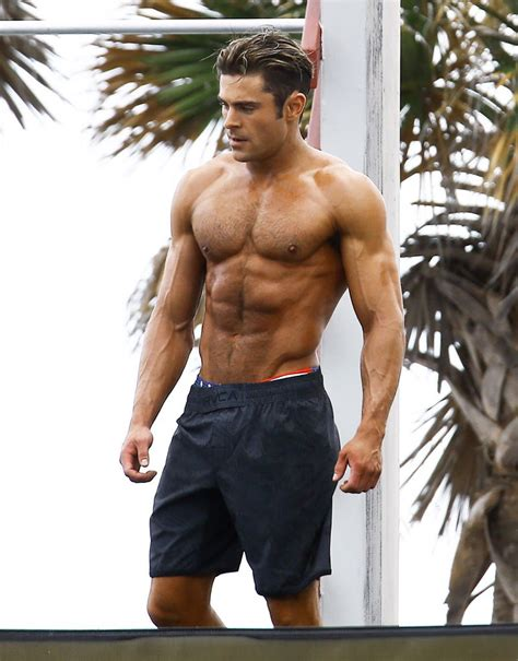 zac efron bench press zac efron s insane body transformation through the years