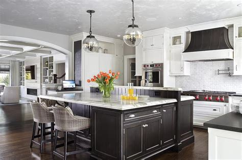 Distressed Black Kitchen Island White And Gray Kitchen With Gold Pendants And Dip Dyed Counter Stools Contemporary Kitchen