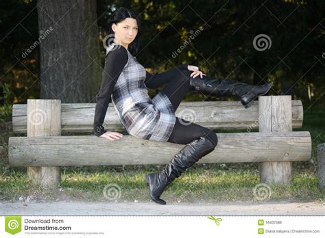 posing bench woman posing on bench in the autumn park royalty free