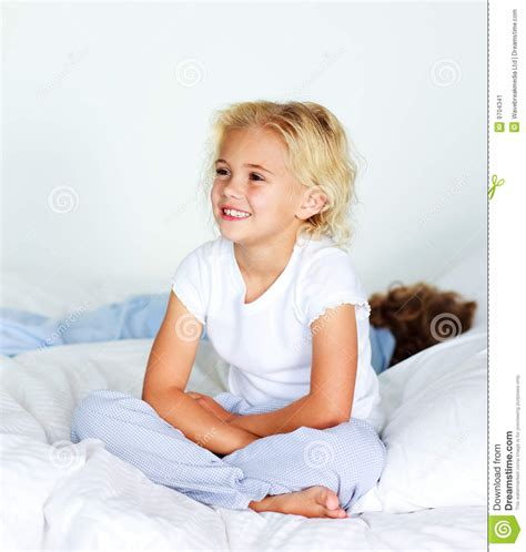 girl sitting on bed little girl sitting on bed before sleeping stock image