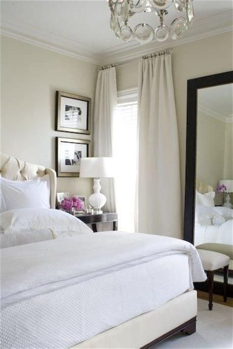 chic soft bedroom design with sand beige paint color walls silk drapes