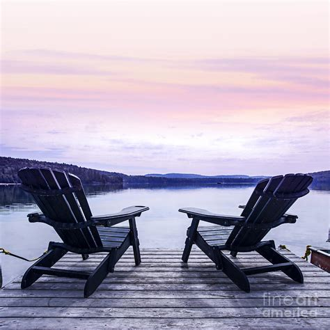 boat dock chairs chairs on lake dock photograph by elena elisseeva