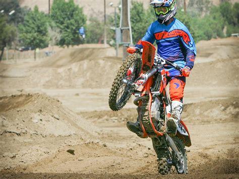 how to wheelie a motocross bike tip how to wheelie dirt rider