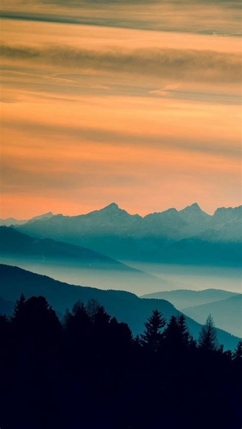 wallpaper for iphone landscape blue mountains orange clouds sunset landscape iphone
