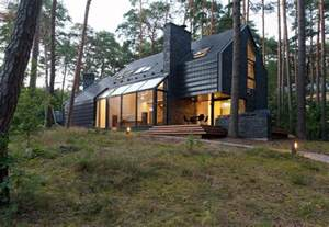 modern forest house dedicated to blues black house
