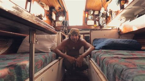 living on a boat jobs man quits job and lives adventurously tiny in sailboat