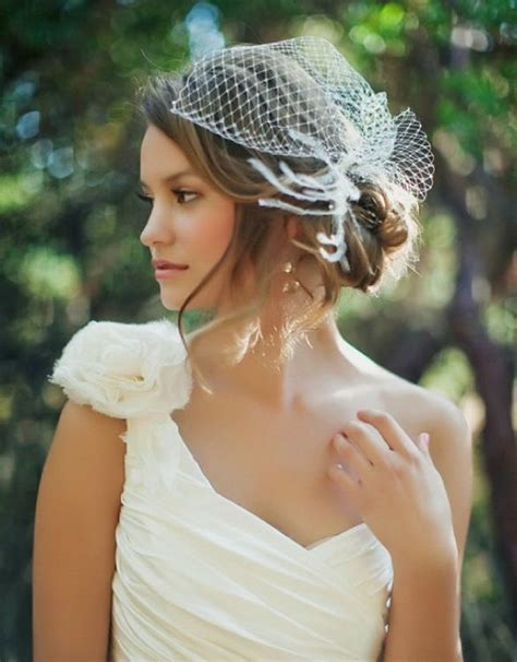 bun hairstyles for evening gowns side bun with birdcage veil wedding hairstyles to wear