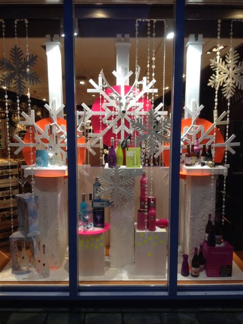 design ideas holiday store winter themed window display at liquor store styled and