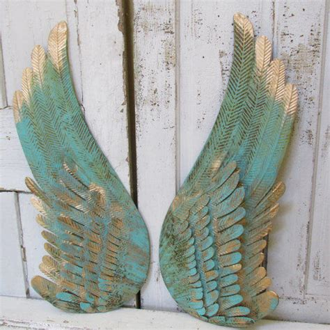turquoise metal angel wings wall decor