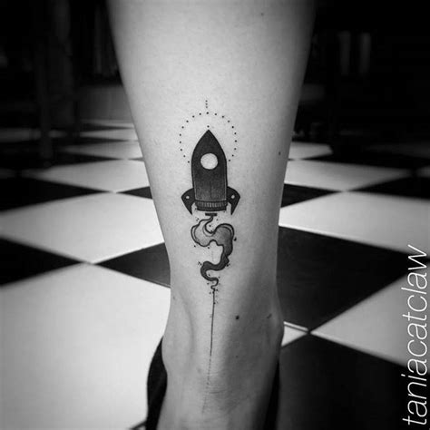 small rocket tattoo on the right achilles heel