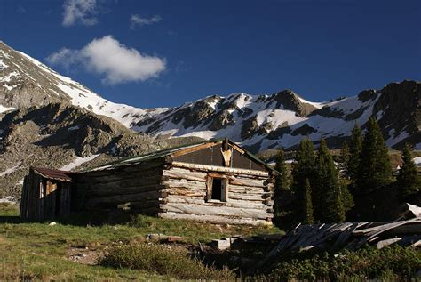 cabin in rocky mountains photograph by michael j bauer