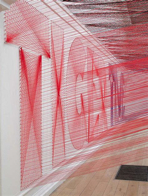 Typographic String - pae white typography yarn installation
