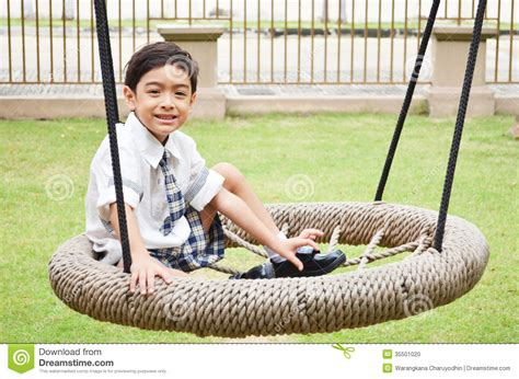 play boy swing videos student boy play swing at school stock photo image 35501020