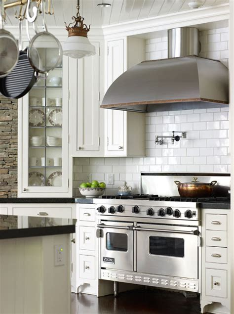 small white kitchen with steel hood stainless steel dome range hood traditional kitchen