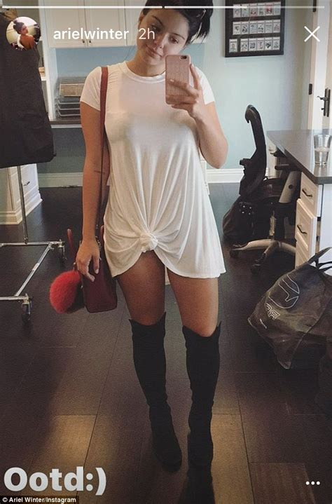 Nothing But Black Shirt ariel winter wears nothing but a white t shirt and boots