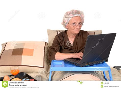 working from bed businesswoman in bed working royalty free stock photo