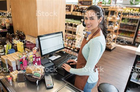cashier working at the grocery store stock photo 534305902