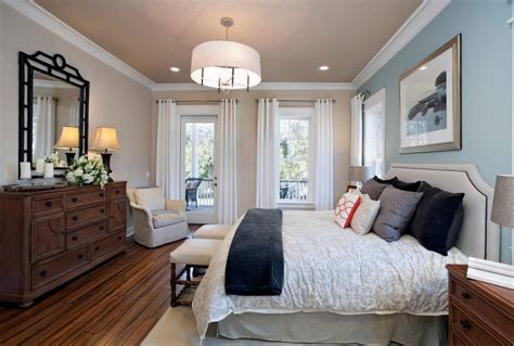 Blue accent wall bedroom traditional with white curtains dark floor drumshade pendant light