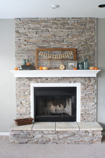 fireplace gray walls white mantel box frame stone