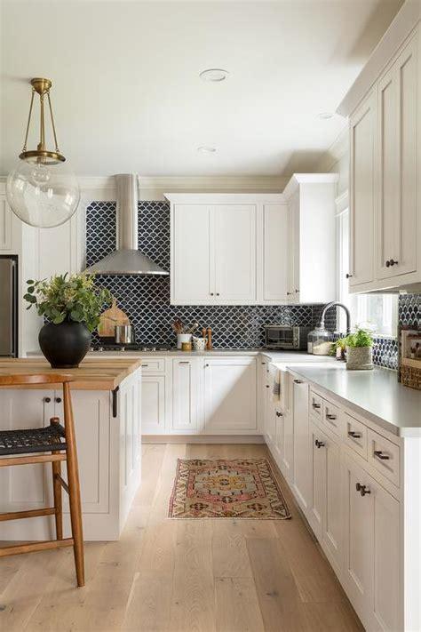 black and white kitchen backsplash black backsplash tiles with white cabinets transitional